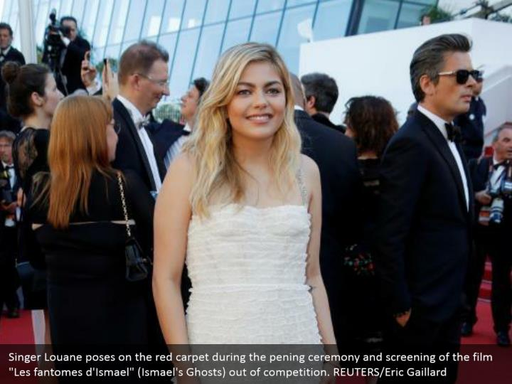 "Singer Louane poses on the red carpet during the pening ceremony and screening of the film ""Les fantomes d'Ismael"" (Ismael's Ghosts) out of competition. REUTERS/Eric Gaillard"