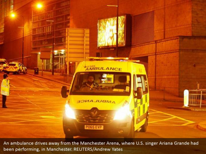 An ambulance drives away from the Manchester Arena, where U.S. singer Ariana Grande had been performing, in Manchester. REUTERS/Andrew Yates