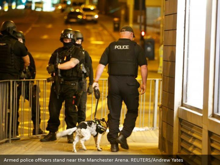 Armed police officers stand near the Manchester Arena. REUTERS/Andrew Yates