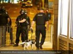 armed police officers stand near the manchester