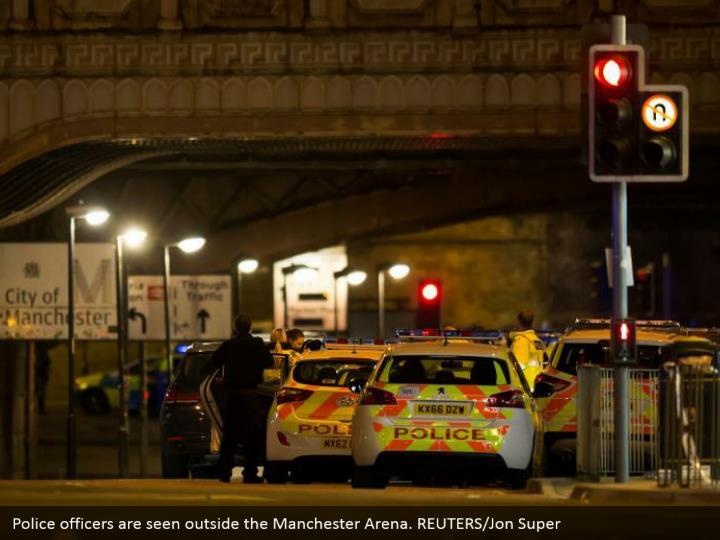 Police officers are seen outside the Manchester Arena. REUTERS/Jon Super