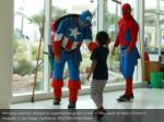 window washers dressed as superheroes greet