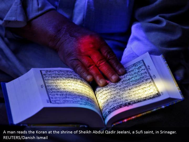 A man reads the Koran at the shrine of Sheikh Abdul Qadir Jeelani, a Sufi saint, in Srinagar. REUTERS/Danish Ismail