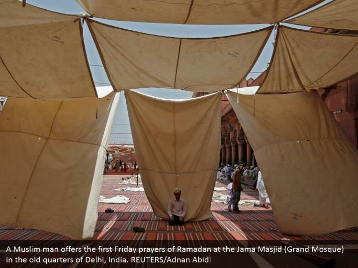 A Muslim man offers the first Friday prayers of Ramadan at the Jama Masjid (Grand Mosque) in the old quarters of Delhi, India. REUTERS/Adnan Abidi