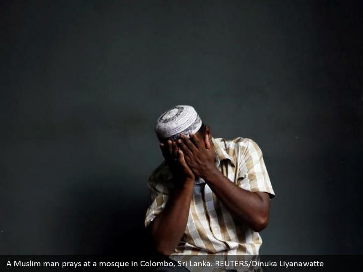 A Muslim man prays at a mosque in Colombo, Sri Lanka. REUTERS/Dinuka Liyanawatte