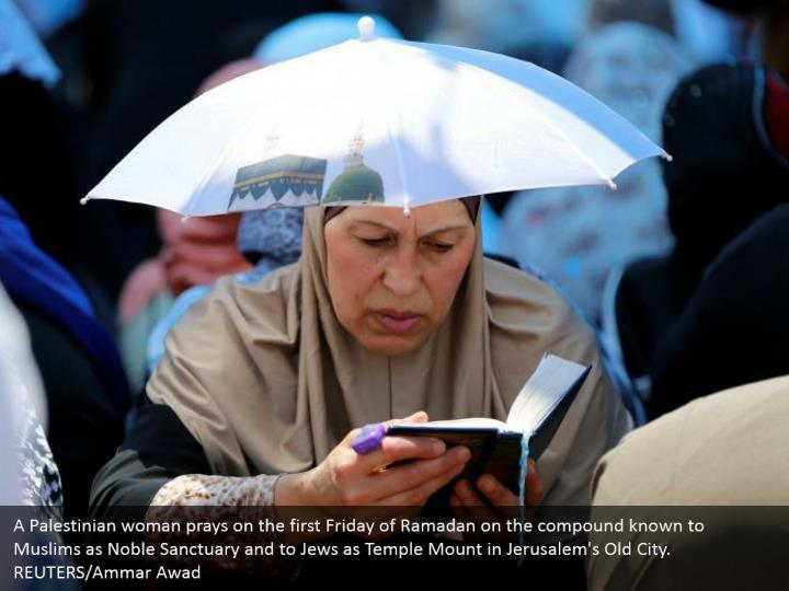 A Palestinian woman prays on the first Friday of Ramadan on the compound known to Muslims as Noble Sanctuary and to Jews as Temple Mount in Jerusalem's Old City. REUTERS/Ammar Awad