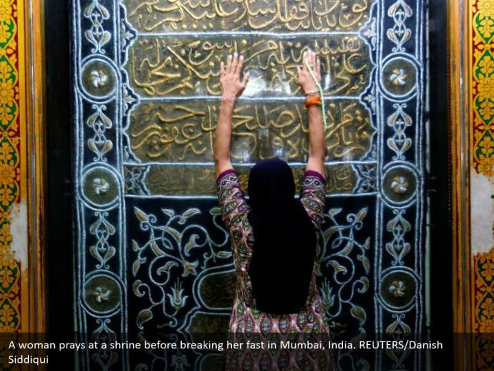 A woman prays at a shrine before breaking