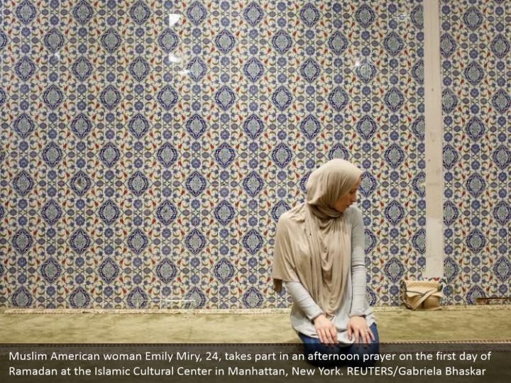 Muslim American woman Emily Miry, 24, takes part in an afternoon prayer on the first day of Ramadan at the Islamic Cultural Center in Manhattan, New York. REUTERS/Gabriela Bhaskar