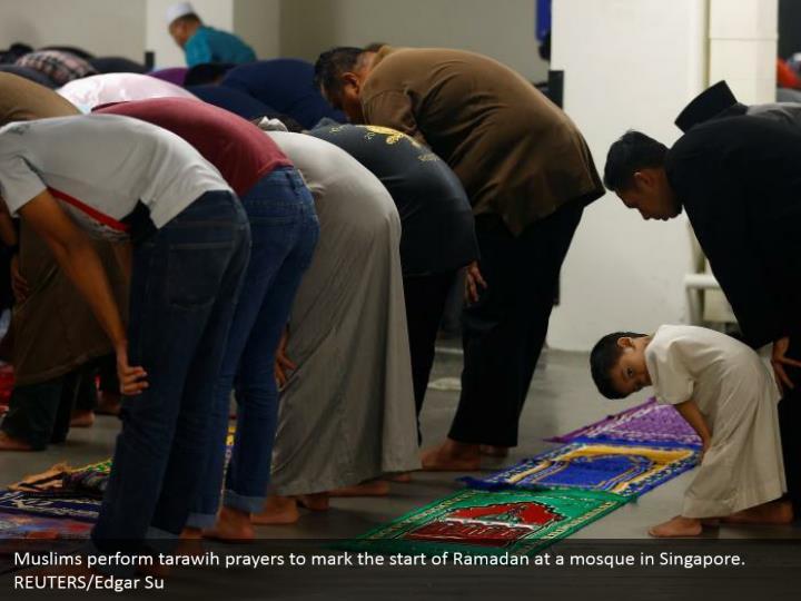 Muslims perform tarawih prayers to mark the start of Ramadan at a mosque in Singapore. REUTERS/Edgar Su
