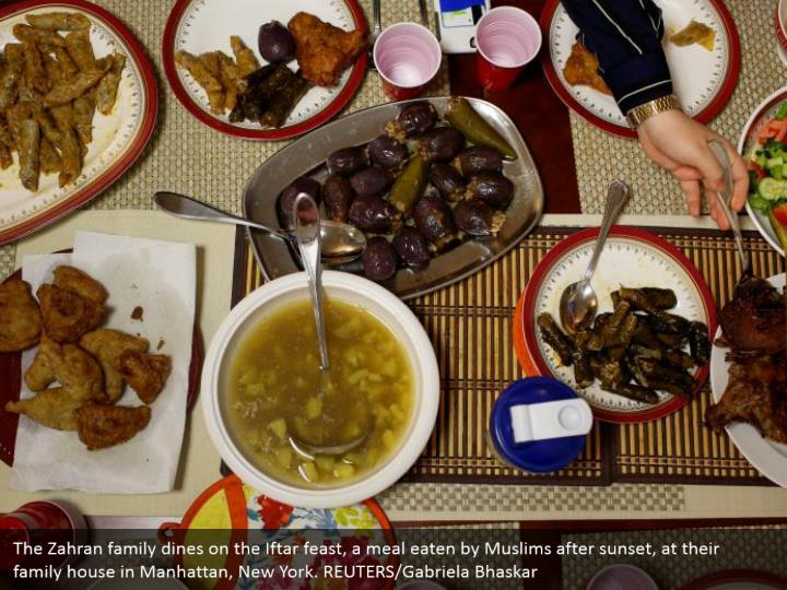 The Zahran family dines on the Iftar feast, a meal eaten by Muslims after sunset, at their family house in Manhattan, New York. REUTERS/Gabriela Bhaskar