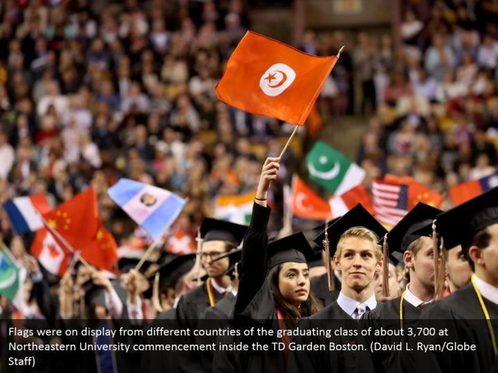 Flags were on display from different countries of the graduating class of about 3,700 at Northeastern University commencement inside the TD Garden Boston. (David L. Ryan/Globe Staff)