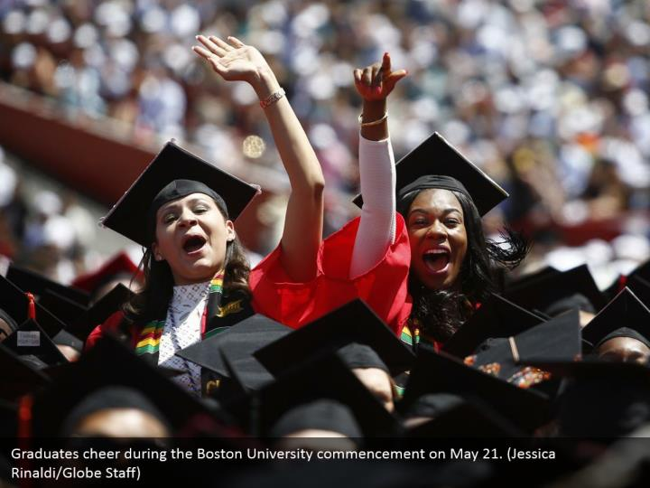 Graduates cheer during the Boston University commencement on May 21. (Jessica Rinaldi/Globe Staff)