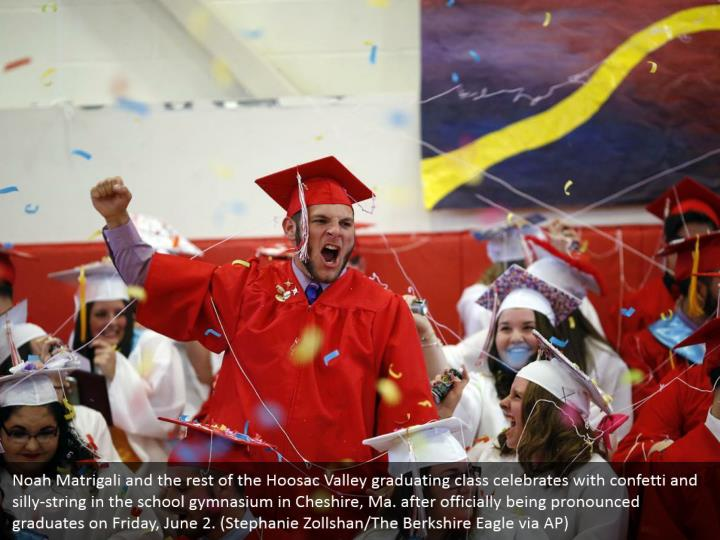 Noah Matrigali and the rest of the Hoosac Valley graduating class celebrates with confetti and silly-string in the school gymnasium in Cheshire, Ma. after officially being pronounced graduates on Friday, June 2. (Stephanie Zollshan/The Berkshire Eagle via AP)
