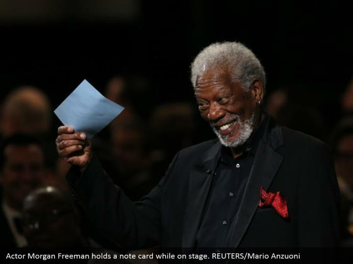 Actor Morgan Freeman holds a note card while on stage. REUTERS/Mario Anzuoni