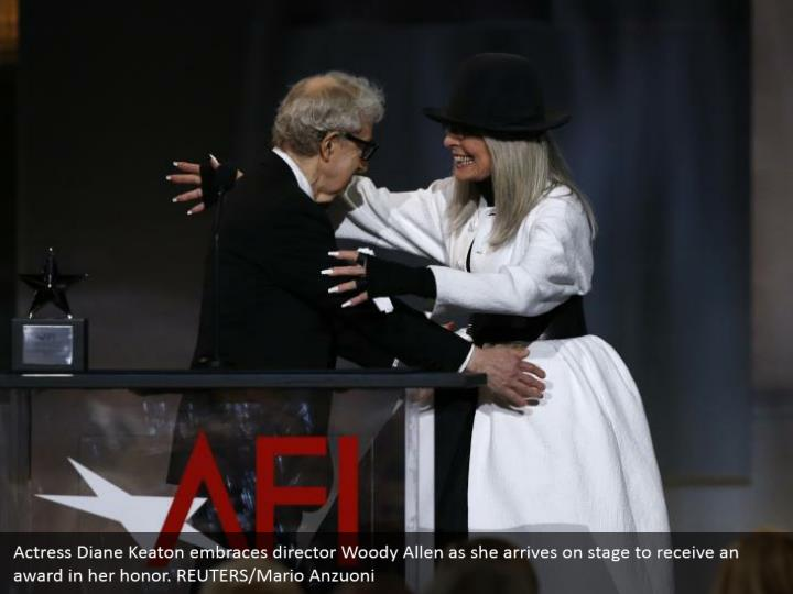 Actress Diane Keaton embraces director Woody Allen as she arrives on stage to receive an award in her honor. REUTERS/Mario Anzuoni