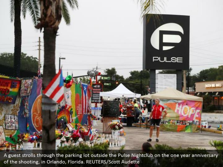 A guest strolls through the parking lot outside the Pulse Nightclub on the one year anniversary of the shooting, in Orlando, Florida. REUTERS/Scott Audette
