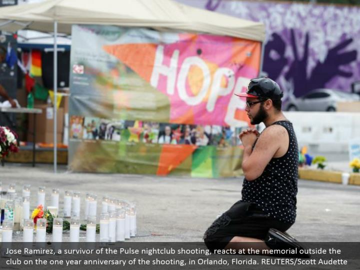 Jose Ramirez, a survivor of the Pulse nightclub shooting, reacts at the memorial outside the club on the one year anniversary of the shooting, in Orlando, Florida. REUTERS/Scott Audette