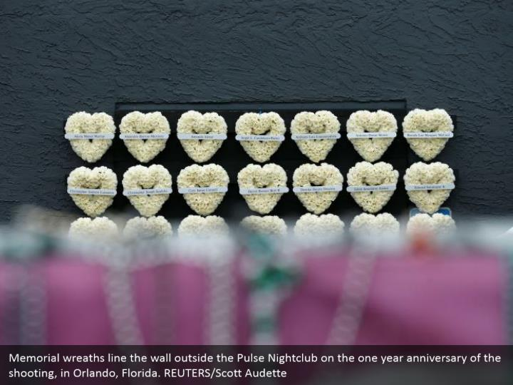 Memorial wreaths line the wall outside the Pulse Nightclub on the one year anniversary of the shooting, in Orlando, Florida. REUTERS/Scott Audette