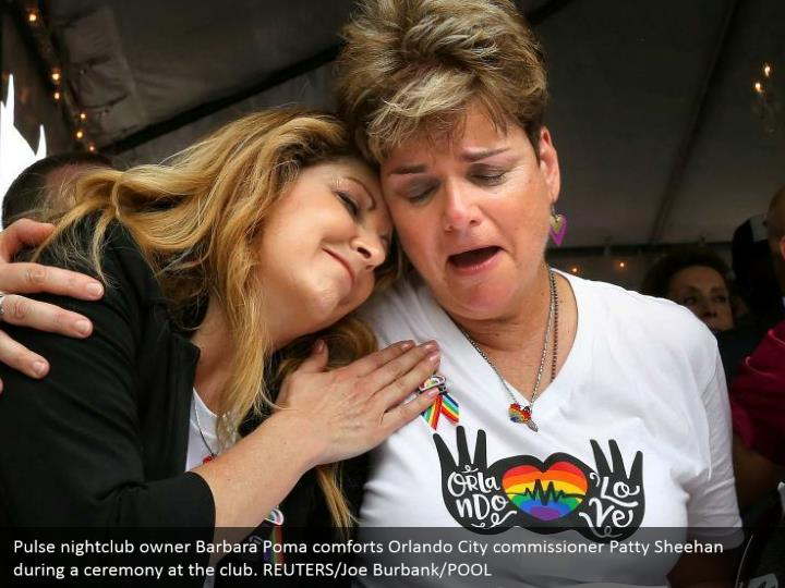 Pulse nightclub owner Barbara Poma comforts Orlando City commissioner Patty Sheehan during a ceremony at the club. REUTERS/Joe Burbank/POOL