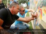 saul barrios l leaves his handprint on a mural