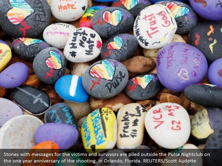 Stones with messages for the victims and survivors are piled outside the Pulse Nightclub on the one year anniversary of the shooting, in Orlando, Florida. REUTERS/Scott Audette
