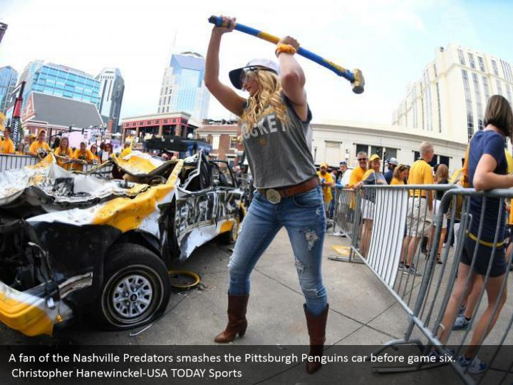 A fan of the Nashville Predators smashes the Pittsburgh Penguins car before game six.  Christopher Hanewinckel-USA TODAY Sports