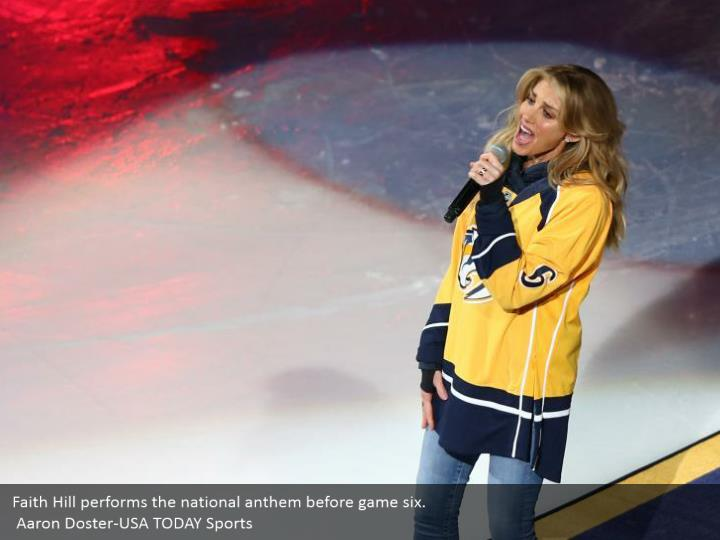 Faith Hill performs the national anthem before game six.  Aaron Doster-USA TODAY Sports