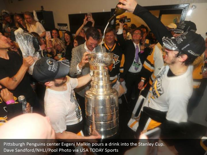 Pittsburgh Penguins center Evgeni Malkin pours a drink into the Stanley Cup. Dave Sandford/NHLI/Pool Photo via USA TODAY Sports