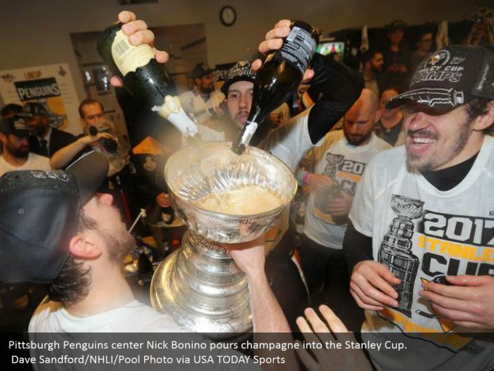 Pittsburgh Penguins center Nick Bonino pours champagne into the Stanley Cup.  Dave Sandford/NHLI/Pool Photo via USA TODAY Sports