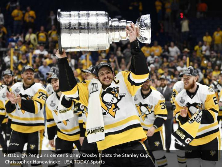 Pittsburgh Penguins center Sidney Crosby hoists the Stanley Cup.  Christopher Hanewinckel-USA TODAY Sports