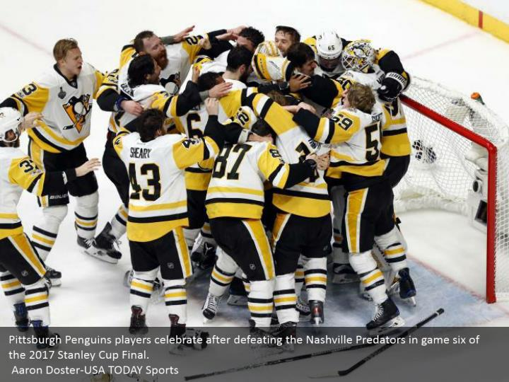 Pittsburgh Penguins players celebrate after defeating the Nashville Predators in game six of the 2017 Stanley Cup Final.  Aaron Doster-USA TODAY Sports