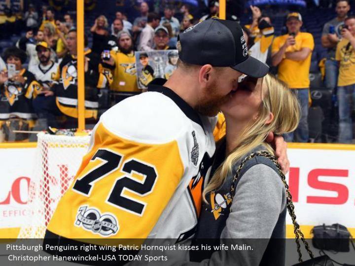 Pittsburgh Penguins right wing Patric Hornqvist kisses his wife Malin.  Christopher Hanewinckel-USA TODAY Sports