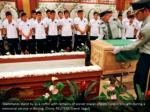 teammates stand by as a coffin with remains