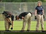 fbi technicians examine the outfield area