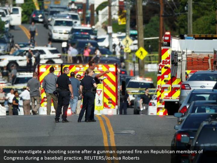 Police investigate a shooting scene after a gunman opened fire on Republican members of Congress during a baseball practice. REUTERS/Joshua Roberts