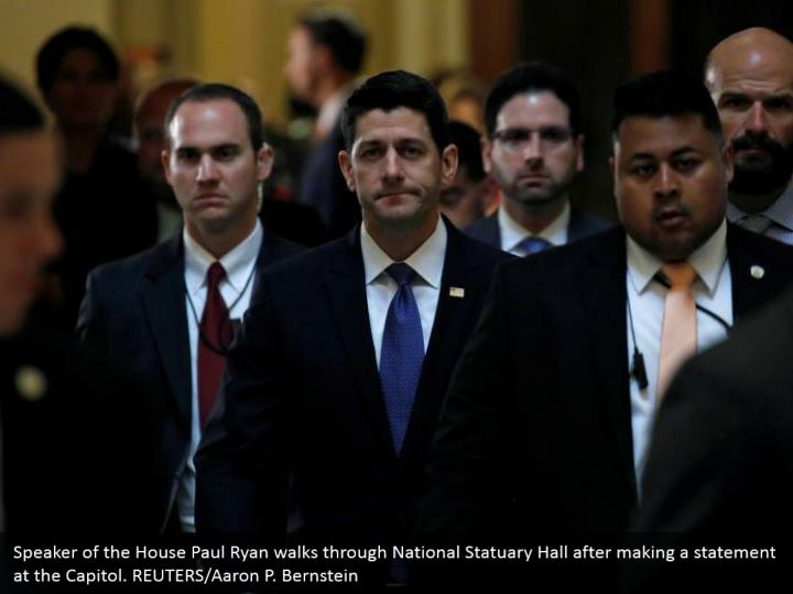 Speaker of the House Paul Ryan walks through National Statuary Hall after making a statement at the Capitol. REUTERS/Aaron P. Bernstein
