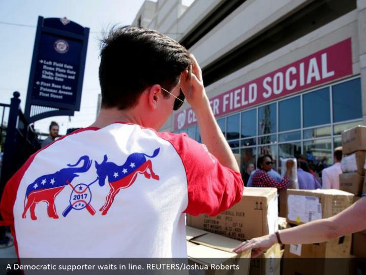 A Democratic supporter waits in line. REUTERS/Joshua Roberts