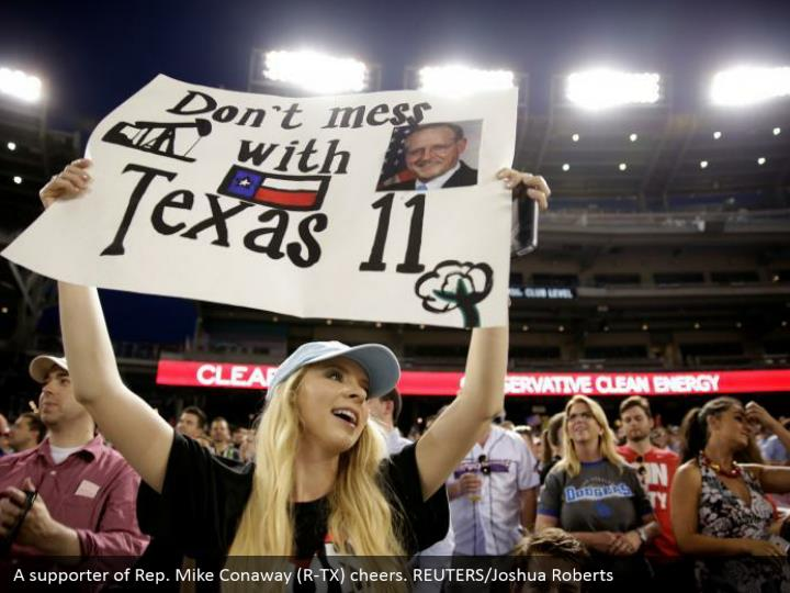 A supporter of Rep. Mike Conaway (R-TX) cheers. REUTERS/Joshua Roberts