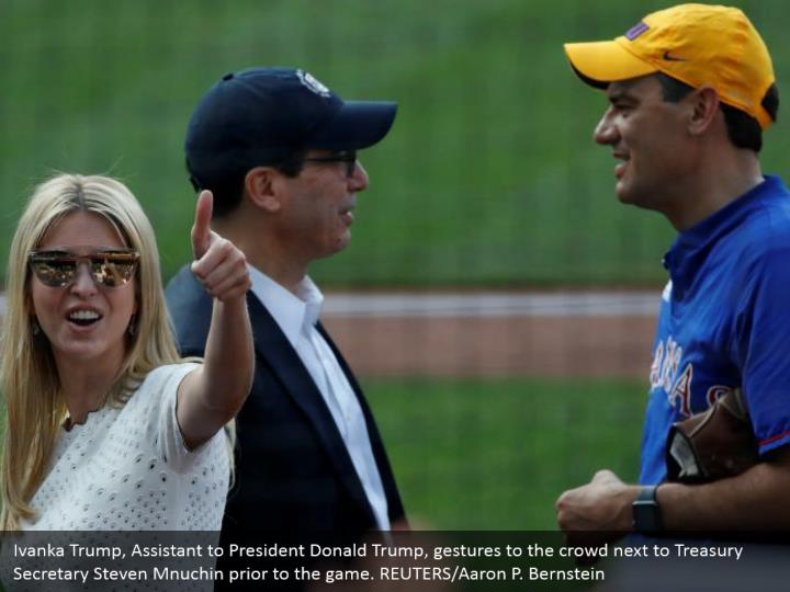 Ivanka Trump, Assistant to President Donald Trump, gestures to the crowd next to Treasury Secretary Steven Mnuchin prior to the game. REUTERS/Aaron P. Bernstein