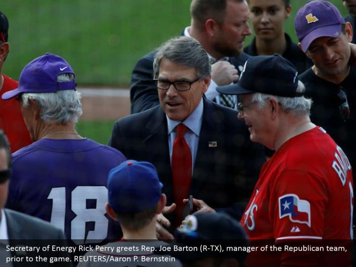 Secretary of Energy Rick Perry greets Rep. Joe Barton (R-TX), manager of the Republican team, prior to the game. REUTERS/Aaron P. Bernstein