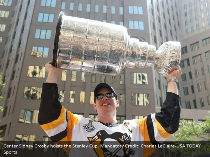 Center Sidney Crosby hoists the Stanley Cup. Mandatory Credit: Charles LeClaire-USA TODAY Sports