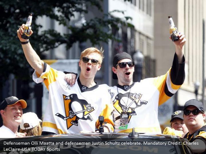 Defenseman Olli Maatta and defenseman Justin Schultz celebrate. Mandatory Credit: Charles LeClaire-USA TODAY Sports