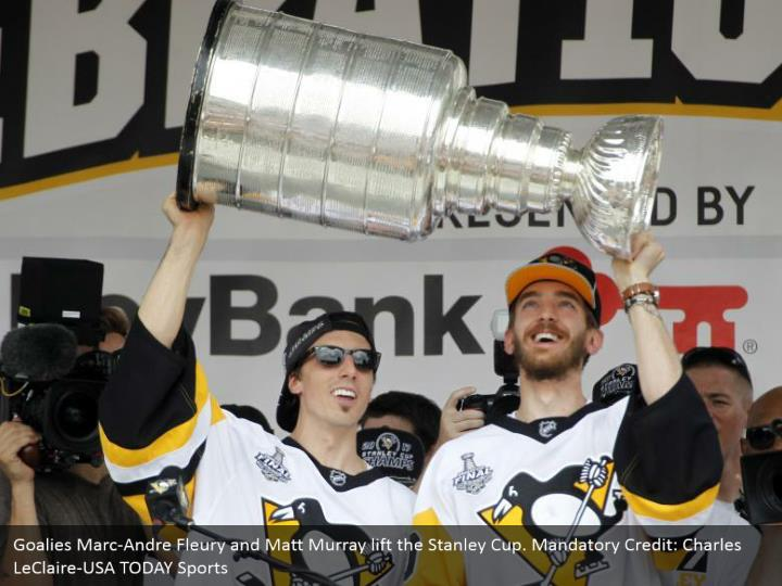 Goalies Marc-Andre Fleury and Matt Murray lift the Stanley Cup. Mandatory Credit: Charles LeClaire-USA TODAY Sports