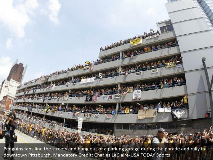 Penguins fans line the streets and hang
