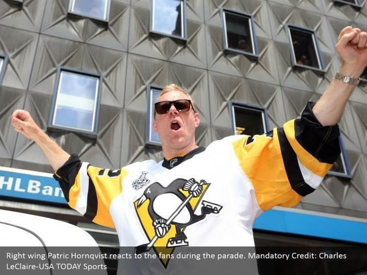 Right wing Patric Hornqvist reacts to the fans during the parade. Mandatory Credit: Charles LeClaire-USA TODAY Sports