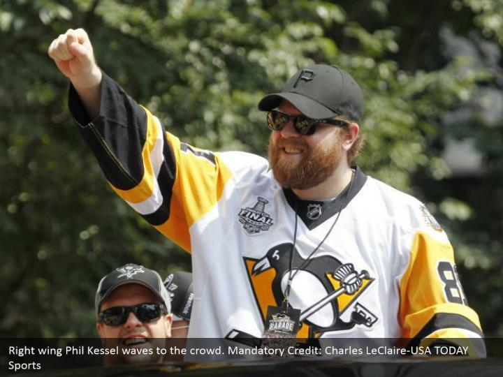 Right wing Phil Kessel waves to the crowd. Mandatory Credit: Charles LeClaire-USA TODAY Sports