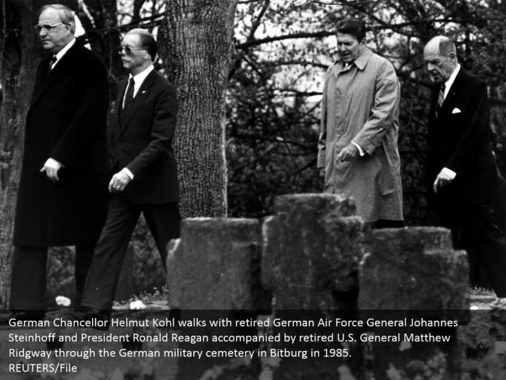 German Chancellor Helmut Kohl walks with retired German Air Force General Johannes Steinhoff and President Ronald Reagan accompanied by retired U.S. General Matthew Ridgway through the German military cemetery in Bitburg in 1985. REUTERS/File