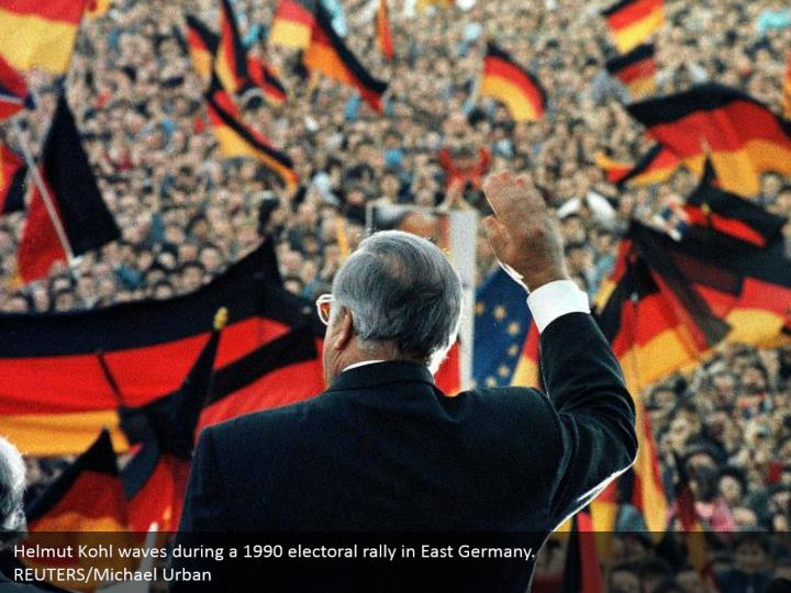 Helmut Kohl waves during a 1990 electoral rally in East Germany.  REUTERS/Michael Urban