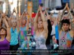 people participate in a yoga class during 1