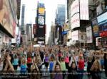 people participate in a yoga class during 14